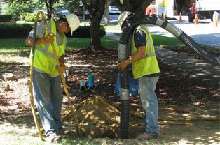 workers cleaning out a sewer main